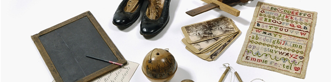 Items of Victorian childhood including a pair of boots, slate and sampler