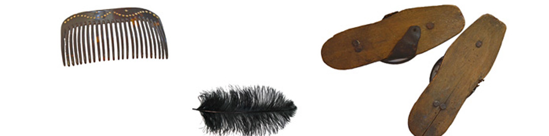 Items of Victorian fashion including a hair comb, pair of wooden pattens, black ostrich feather