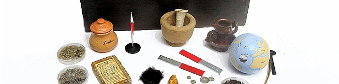 Objects relating to Tudor medicine including a pestle and mortar, leech jar, oil lamp,quill pen and coins