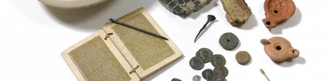Roman items including oil lamp, wax tablet and stylus, coins and gaming counter