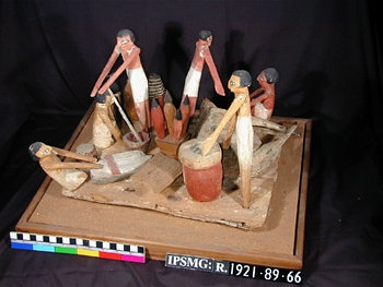 This wooden model was found in a tomb at Sedment in Egypt. It is from the time of the 9th Dynasty and dates from between 2160-2025 BC. It shows people making bread and beer, grinding corn and butchering an ox. It was placed in the tomb so that the dead person would have someone to magically provide food and drink for them in the afterlife.