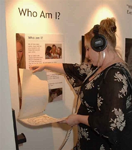 Woman listening to an oral history exhibit