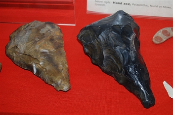 Sharp pieces of brown and black flint used for daily tasks in the Stone Ages