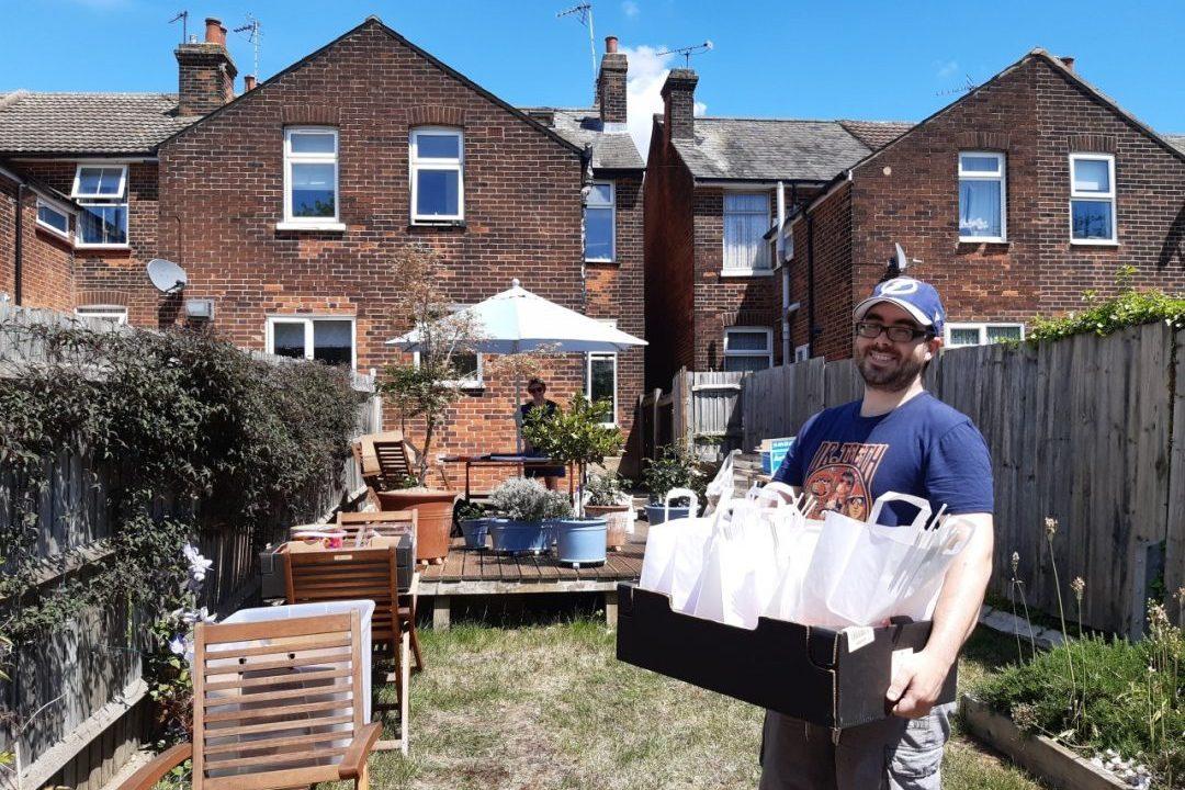 Volunteers assembling activity packs in Eleanors garden