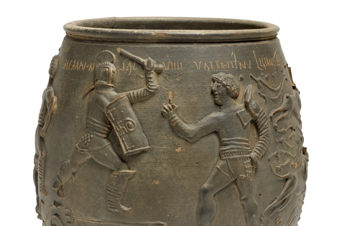 A close up of the Colchester Vase. Two gladiators appear to be fighting