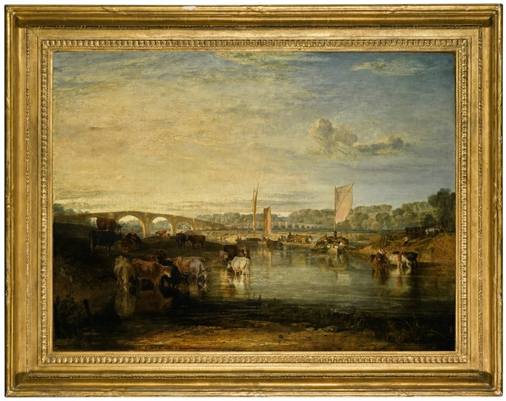 A painting of a river. Cows are grazing on the left hand bank and standing in the shallows. On the right there are boats in the distance. Bridges and trees can be seen in the background. The painting is surrounded by an ornate gold frame
