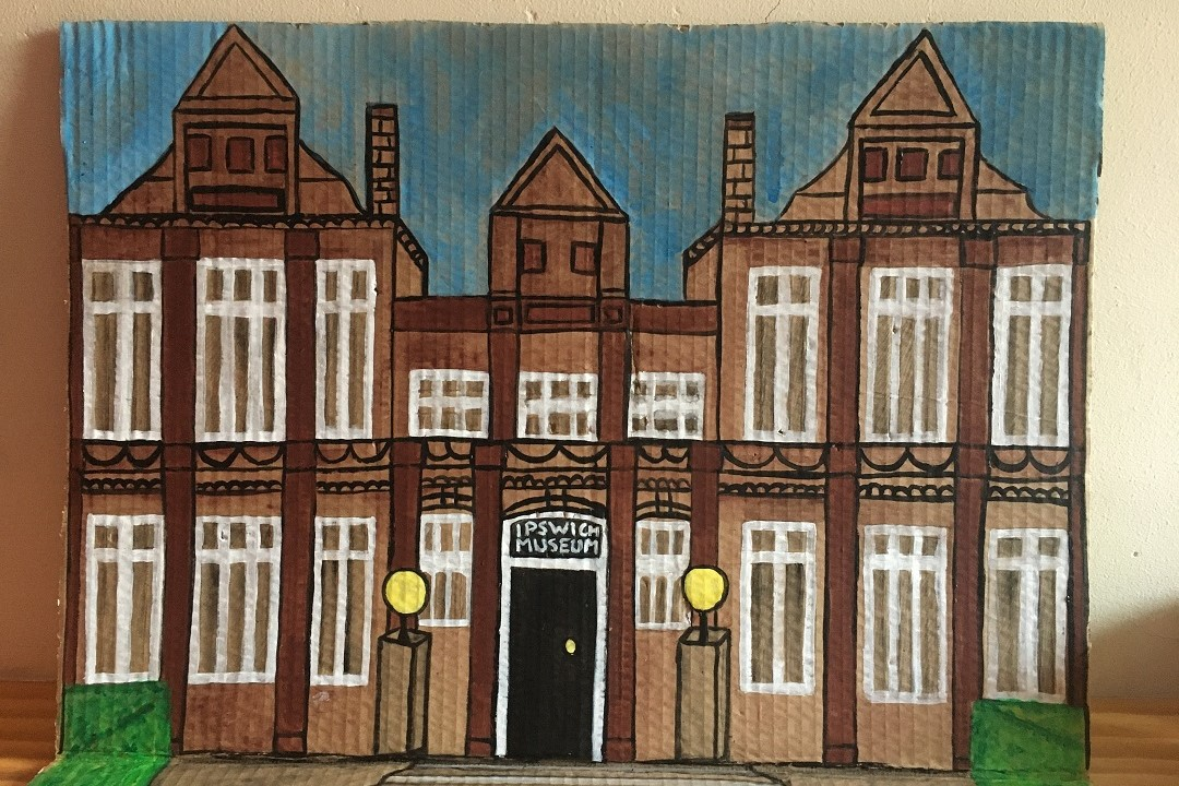 Ipswich Museum painted onto cardboard. The building is brown with white window frames and a black front door