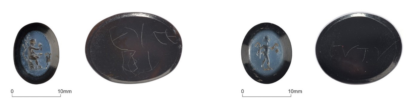 The front and back of two small, blue carved gems. On one gem the satyr is leaning against a tree and holds a cup and bunch of grapes in either hand. On the other, the Satyr holds a bunch of grapes and his pedum (shepherd's crook). The makers names have been inscribed on the back.