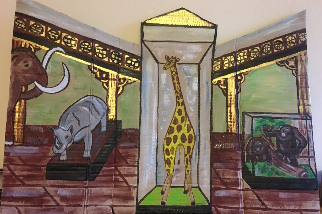 A painting of inside Ipswich Museum, showing the taxidermy giraffe and gorillas inside glass cases, Rosie the rhino and our woolly mammoth