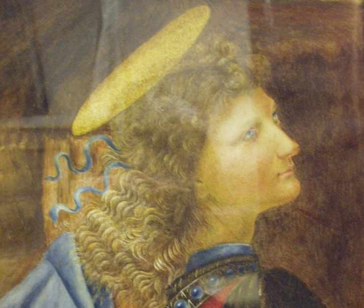 A section of a painting. It depicts the head and shoulders of an angel. The figure is white, with blonde wavy hair and a gold disc above their head. Their gaze is off to the right.