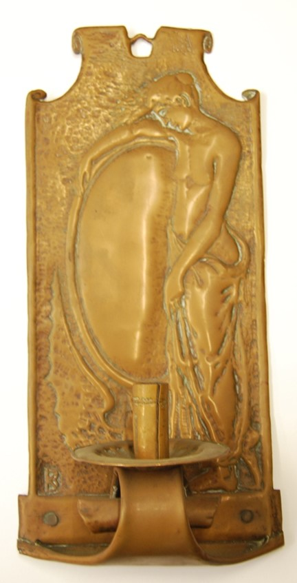 Copper, bracketed candle holder or sconce decorated with a semi-nude female figure next to a mirror mounted on a bird