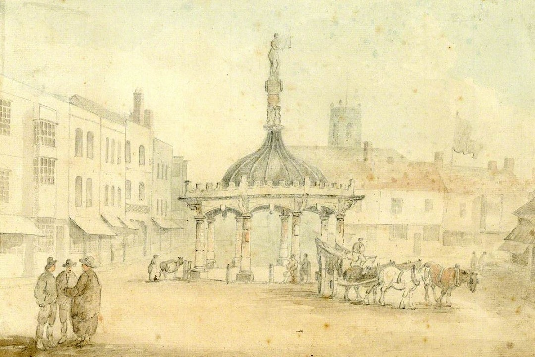 A lightly drawn image showing an open town square. In the centre is a decorative structure similar to a bandstand. It has columns and a pitched roof. Three figures are stood in the foreground to the left and a horse and cart is in the middleground to the right
